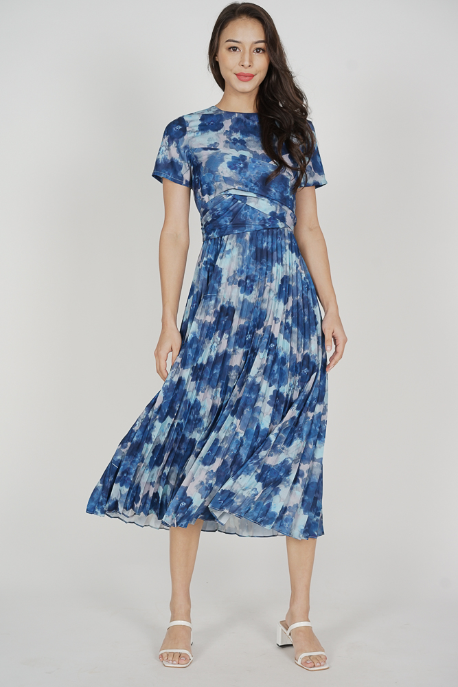 Berni Criss Cross Pleated Dress in Blue Abstract